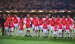 The Arsenal players and Manager Arsene Wenger line up before the match