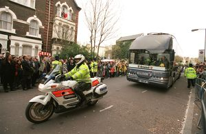 The Arsenal Team Coach arrives outside the East Stand on Avenell Road with a police escort