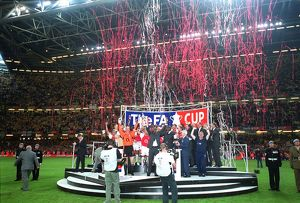 The Arsenal team lift the FA Cup