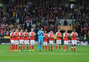 the arsenal team take part in a minutes applause