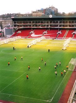 The Arsenal team train on the pitch at Highbury