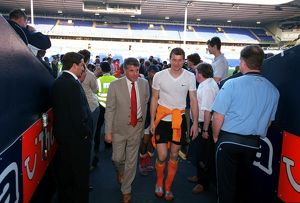 Arsenal Vice Chairman David dein and Jens Lehmann walk up the tunnell at the end of the match
