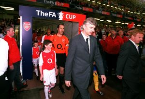 Arsene Wenger the Arsenal Manager leads to team out onto the pitch