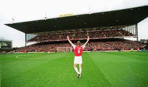 Captain Tony Adams salutes the North Bank before his 500th league match for Arsenal
