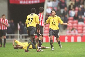 Cesc Fabregas (Arsenal) confronts Dan Smith (Sunderland) after his foul on Abu Diaby