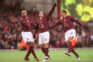 Cesc Fabregas celebrates scoring Arsenal's 1st goal with Thierry Henry and Gilberto
