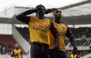 team/players coaches djourou johan/emmanuel adebayor celebrates scoring arsenals
