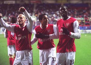 Emmanuel Adebayor celebrates scoring Arsenal's goal with Theo Walcott