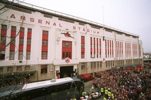 Fans gather outside the East Stand on Avenell Road to watch the Arsenal team entre the stadium