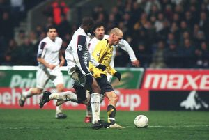 Freddie Ljungberg breaks past Bolton defender Abdoulaye Meite to score the 2nd Arsenal goal