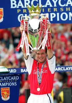 Fredrik Ljungberg lifts the F.A.Barclaycard Premiership Trophy