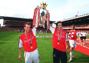 Fredrik Ljungberg and Robert Pires (Arsenal) lift the F.A