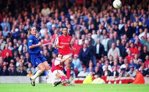 Fredrik Ljungberg shoots past Chelsea goalkeeper Carlo Cudicini to score the 2nd Arsenal goal as Emm