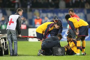 Injured Theo Walcott is treated by Arsenal physio Colin Lewin