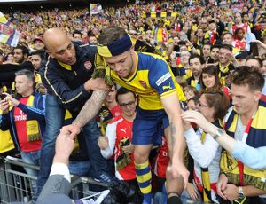 jack wilshere arsenal climbs out of the crowd
