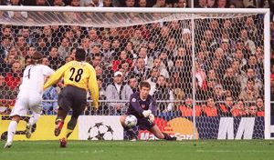 Jens Lehmann (Arsenal) punches clear under pressure from Sergio Ramos (Real)