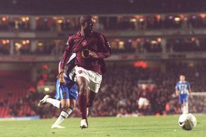Kerrea Gilbert (Arsenal) looks up before crossing the ball for Thierry Henry's winner