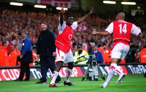 Kolo Toure celebrates with Thierry Henry (Arsenal) after the match