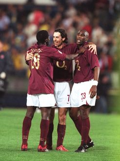 Kolo Toure, Robert Pires and Sol Campbell (Arsenal) celebrate at the end of the match