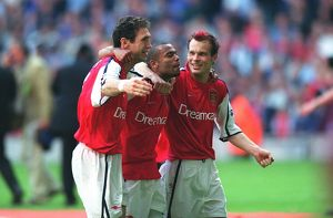 Martin Keown, Ashley Cole and Fredrik Ljungberg celebrate after the match