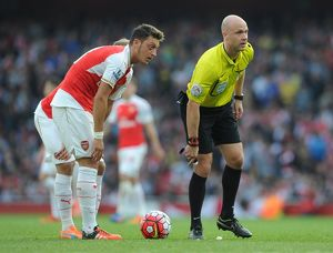 season 2015 16/arsenal v manchester united 2015 16/mesut ozil arsenal referee anthony taylor