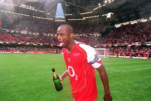 Patrick Vieira (Arsenal) celebrates with some Champagne after the match