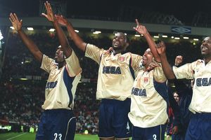 Patrick Vieira, Ashley Cole, Lauren and Sol Campbell celebrate the Arsenal Championship victory afte