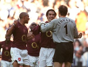 Robert Pires celebrates scoring the Arsenal goal with Gael Clichy and Jens Lehmann