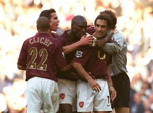 Robert Pires celebrates scoring the Arsenal goal with Sol Campbell, Gael Clichy