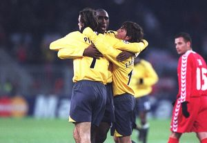 Robert Pires celebrates scoring a goal for Arsenal with Sol Campbell and Cesc Fabregas