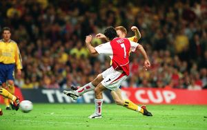 Robert Pires shoots past Southampton defender Michael Svensson to score the Arsenal goal