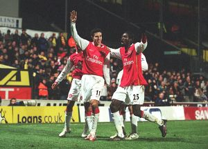 Robin van Persie celebrates scoring the 2nd Arsenal goal with Emmanuel Adebayor