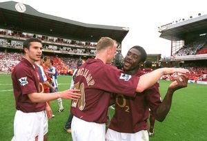 Robin van Persie, Dennis Bergkamp and Kolo Toure celebrate at the end of the match