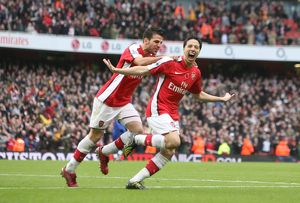 team/players coaches fabregas cesc/samir nasri celebrates scoring 2nd arsenal goal