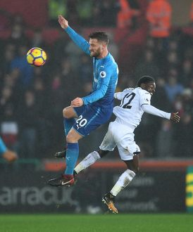 season 2017 18/swansea city v arsenal 2017 18/shkodran mustafi arsenal nathan dyer swansea