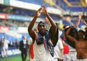 Sol Campbell (Arsenal) celebrates winning the League
