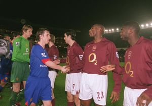 Sol Campbell and Kolo Toure (Arsenal) shake hands with Gary Neville (Man Utd)