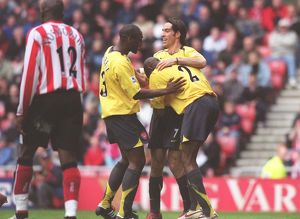 Sol Campbell, Robert Pires and Abu Diaby celebrate the 1st goal