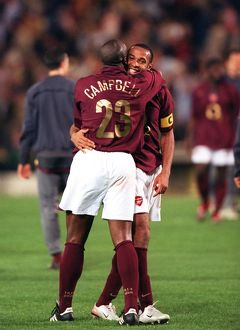 Sol Campbell and Thierry Henry (Arsenal) celebrate at the end of the match