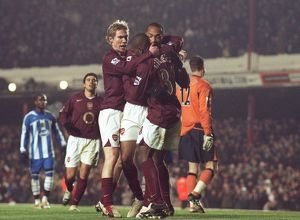 Theirry Henry celebrates scoring Arsenal's 1st goal with Kerrea Gilbert and Alex Hleb