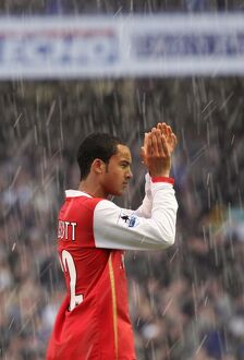 Theo Walcott applauds the Arsenal fans after the match