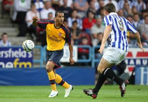 Theo Walcott (Arsenal) Andy Butler (Huddersfield)