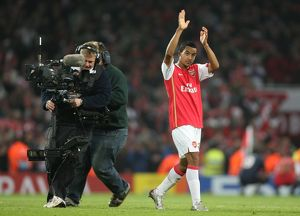 Theo Walcott claps the fans at the end of the match