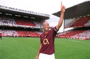 Thierry Henry (Arsenal) celebrates as news of the Totteham score reaches the ground