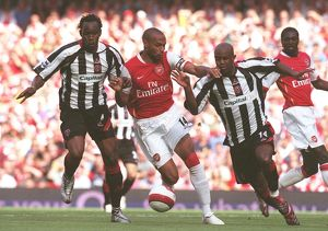 Thierry Henry (Arsenal) Claude Davis and David Sommeil (Sheff Utd)