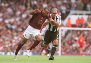 Thierry Henry (Arsenal) Stephen Carr (Newcastle). Arsenal 2:0 Newcastle United