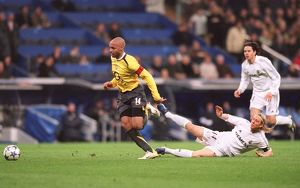 Thierry Henry beats Guti (Real) on his way to scoring Arsenal's goal