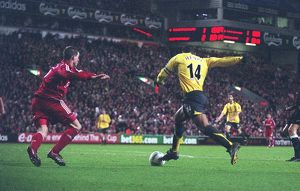 Thierry Henry breaks past Liverpool defender Daniel Agger to score the 3rd Arsenal goal