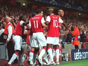 Thierry Henry celebrates scoring Arsenal's 1st goal with Emmanuel Eboue