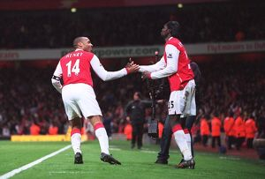 Thierry Henry celebrates scoring Arsenal's 2nd goal with Emmanuel Adebayor
